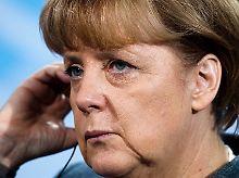 Angela Merkel reagiert verhalten.